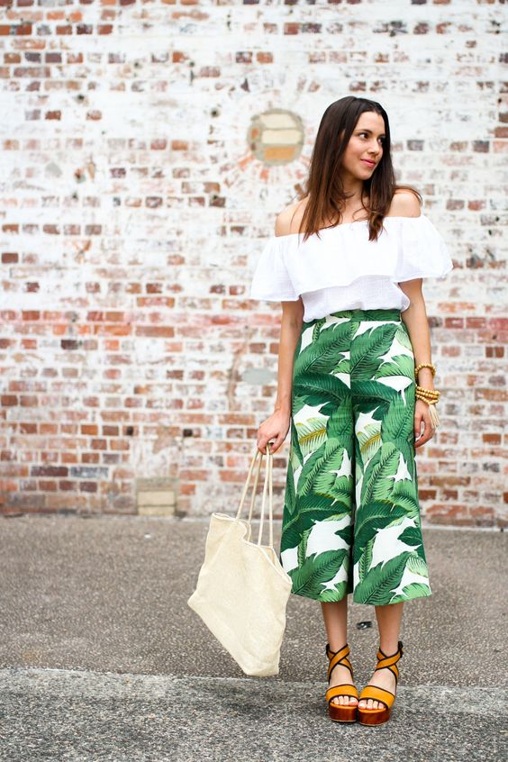 culottes, a white off the shoulder top and orange platform shoes