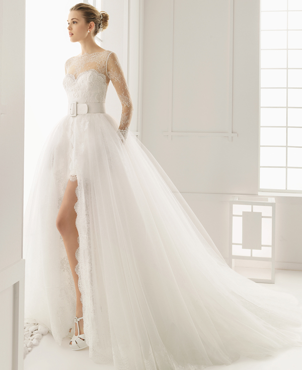 elegant short lace wedding dress with an illusion neckline and long lace sleeves plus a large overskirt