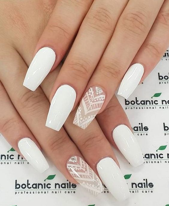 white nails and white lace and rhinestone accent ones