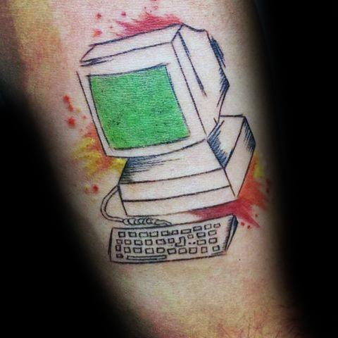 Computer with green screen tattoo