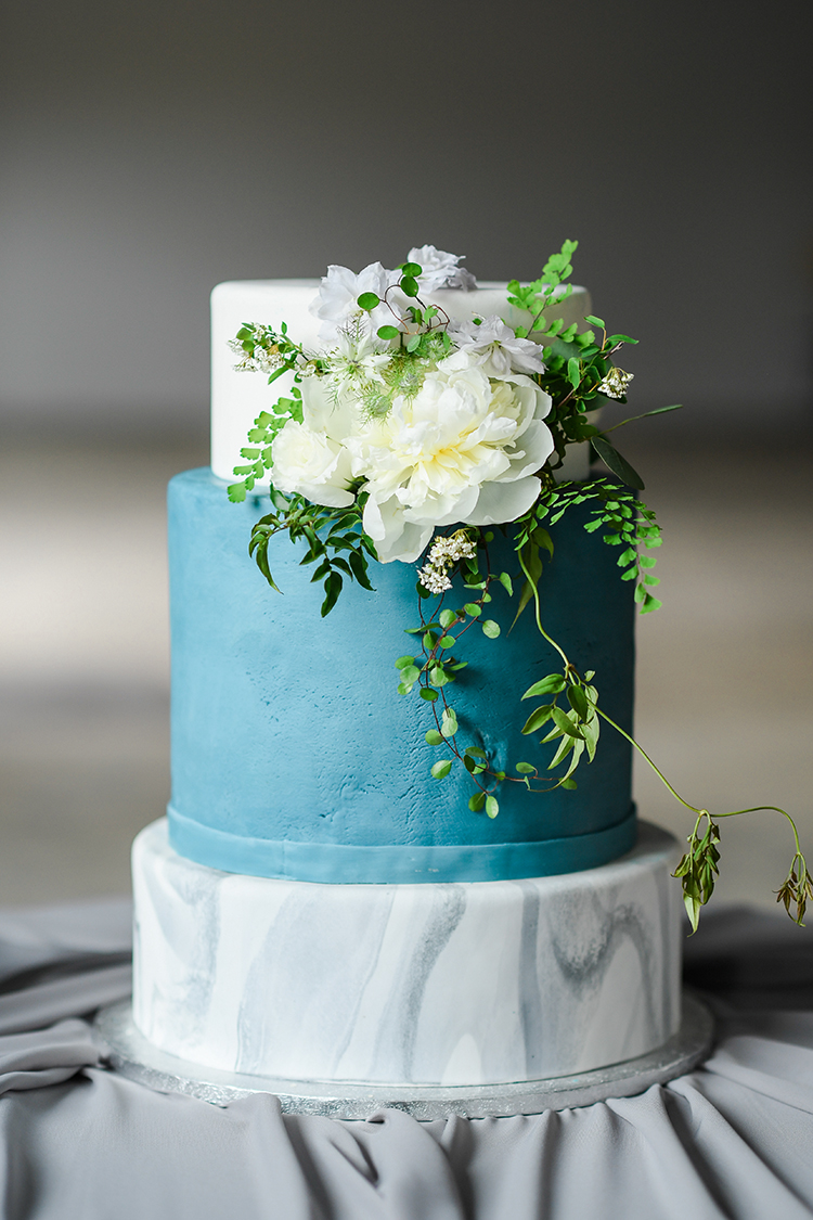blue and marble wedding cakes - photo by Kate Noelle Photography http://ruffledblog.com/chic-wedding-ideas-inspired-by-partly-cloudy-skies