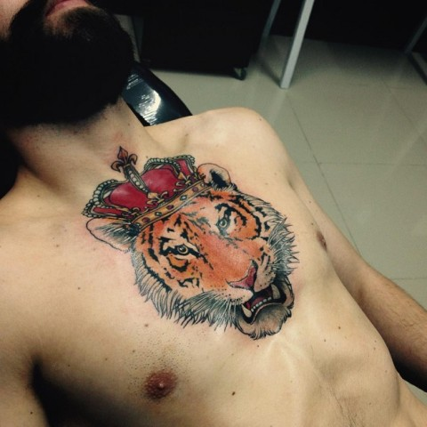 Tiger with crown tattoo on the chest