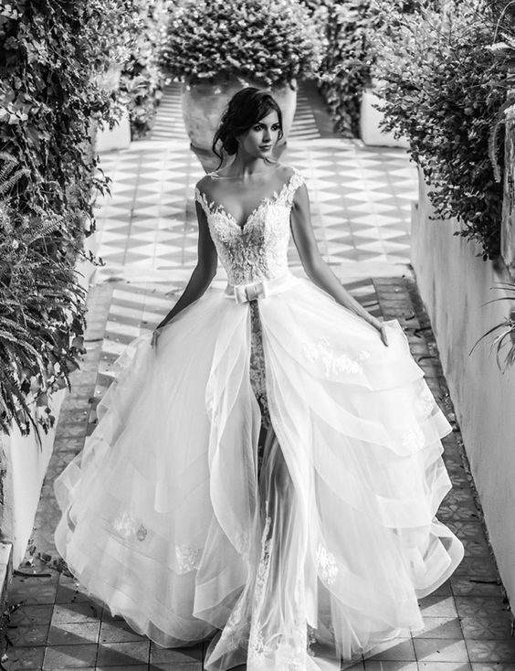 illusion neckline sheath wedding dress with a layered overskirt looks heavenly