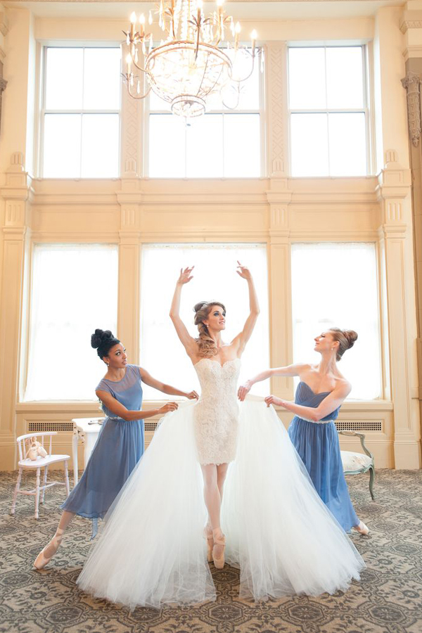 a short strapless lace wedding dress with a full tulle overskirt for the ceremony