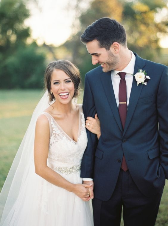 a navy two piece wedding suit with a white shirt and a plum tie