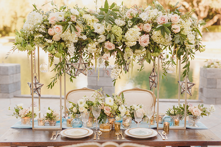 romantic wedding tables with tall centerpieces - photo by Kristen Booth Photographer http://ruffledblog.com/majestic-castle-wedding-inspiration-with-celestial-accents