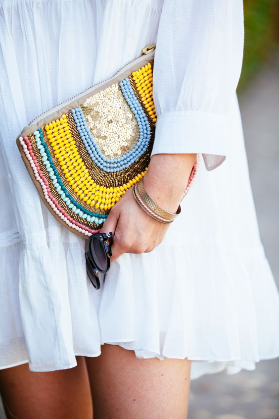 a half circle clutch with colorful beads and sequins is great for a neutral summer outfit