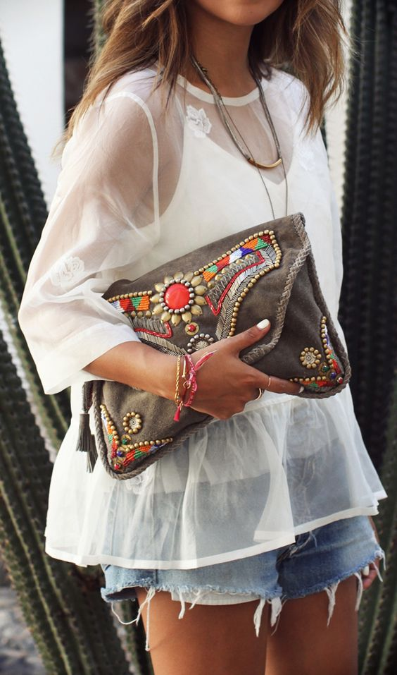 a large brown leather clutch with colorful beads and rhinestones for a boho look