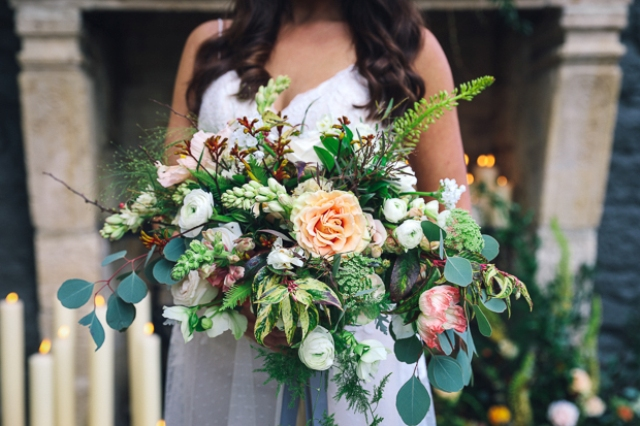 The bridal bouquet was made with different flowers and leaves in peachy and creamy tones
