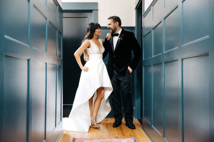 The Carolina Herrara gown was cut to a high low version, and the groom was wearing a tuxedo with a velvet jacket