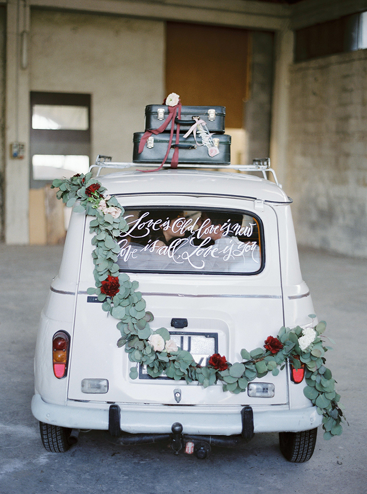 vintage getaway cars - photo by Linda Nari Photography http://ruffledblog.com/tuscan-warehouse-wedding-inspiration-with-a-floral-bridal-gown