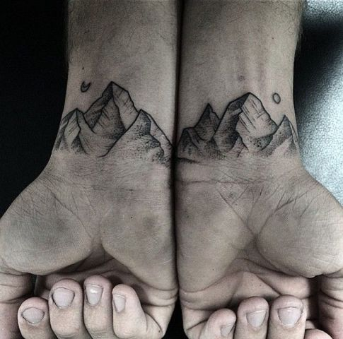 Mountain tattoos on the wrists