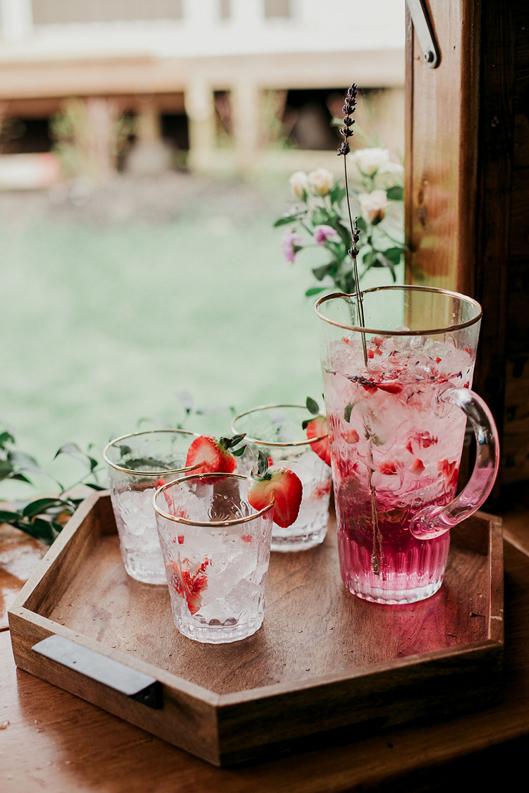 flirty pink wedding drinks - photo by Sarah White Photography http://ruffledblog.com/boho-bridal-shower-inspiration-for-your-bride-tribe