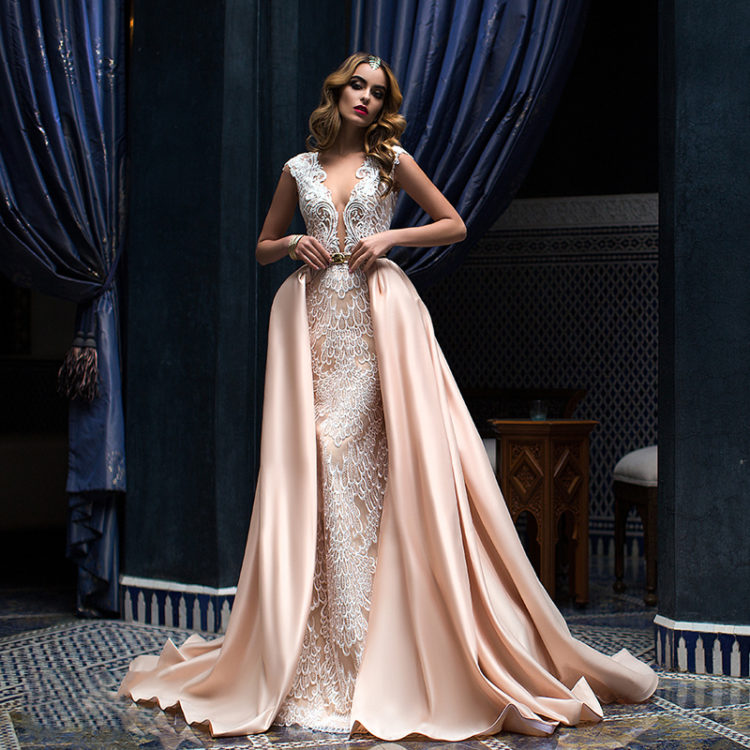 pink white lace wedding dress with a plunging neckline and wide straps, a plain overskirt