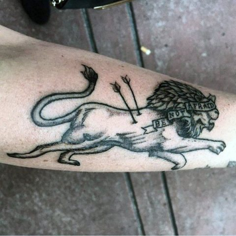 Lion with arrows tattoo on the hand
