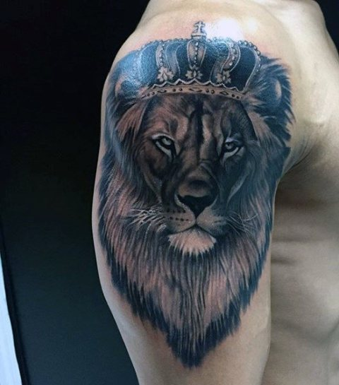 Lion with crown tattoo on the arm and shoulder