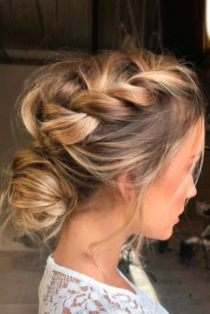 messy and loose updo with a side braid and a low bun
