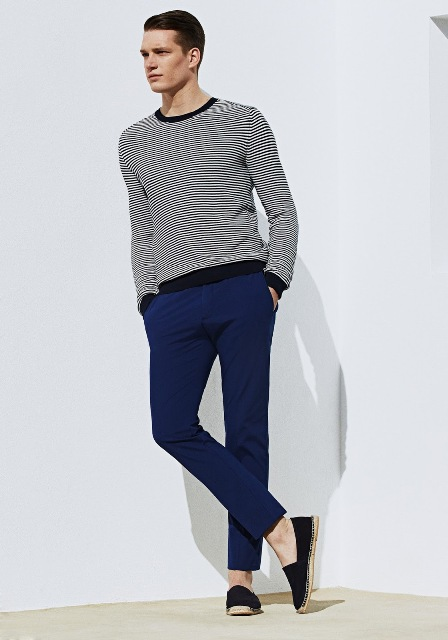 With striped shirt and navy blue pants