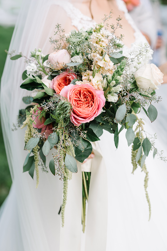 The bridal bouquet with much greenery and pink and blush flowers, pure tenderness