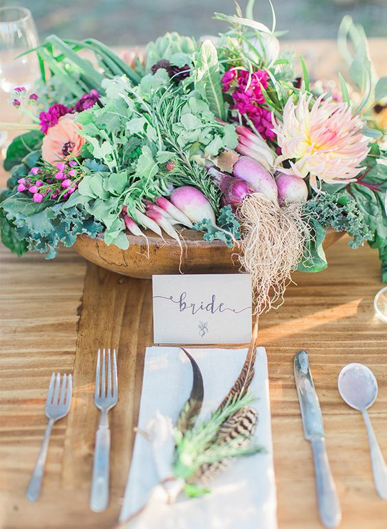a wooden bowl with radish, onions, artichokes, wildflowers for a farm-to-table wedding