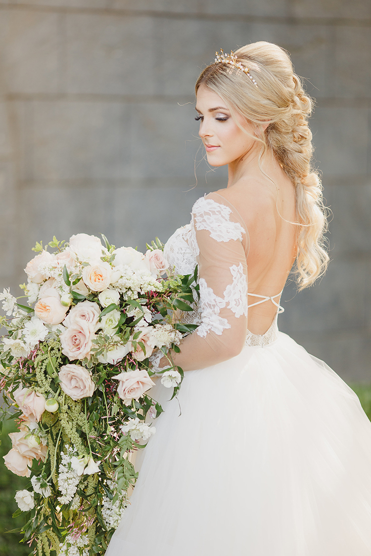 lace sleeve wedding dresses - photo by Kristen Booth Photographer http://ruffledblog.com/majestic-castle-wedding-inspiration-with-celestial-accents