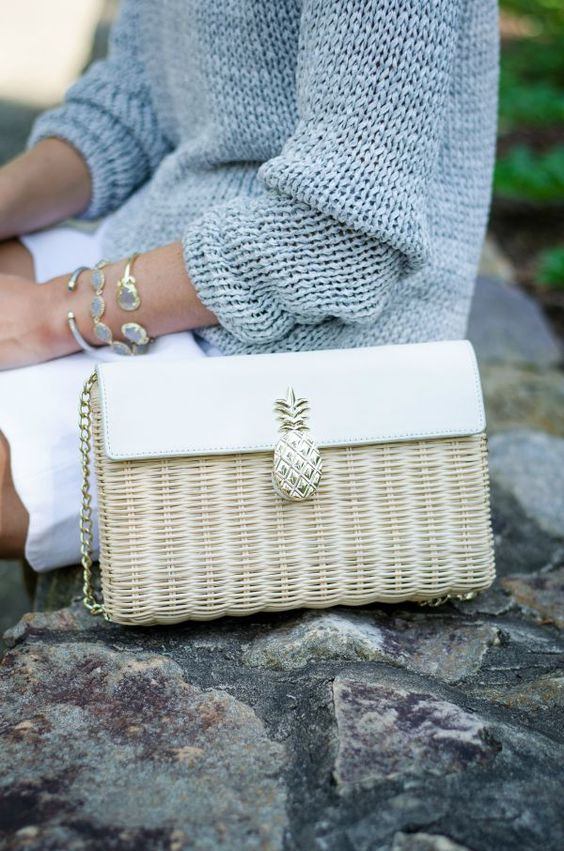 a straw and leather neutral bag with a pineapple detail is a cute summer piece