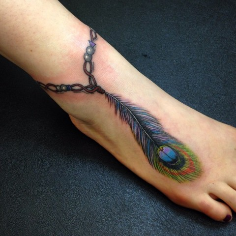 Bracelet with peacock feather tattoo on the ankle