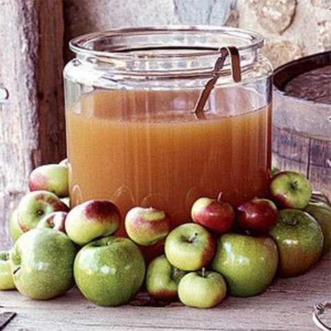 serve apple cider covering the tank with fresh apples to make it clear what's inside