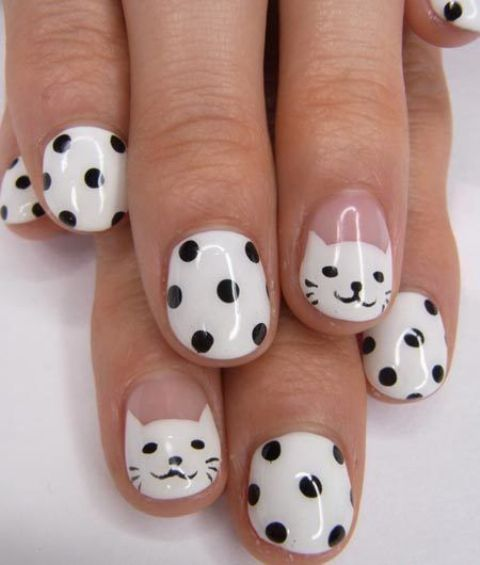 white with black polka dot nails and accent kitty ones