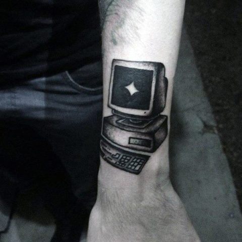 Black computer tattoo on the hand