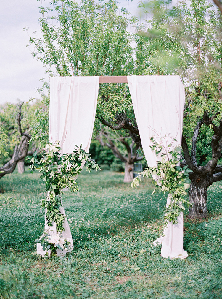 backyard garden wedding ceremonies - photo by Melissa Jill Photography http://ruffledblog.com/citrus-and-copper-orchard-wedding-inspiration