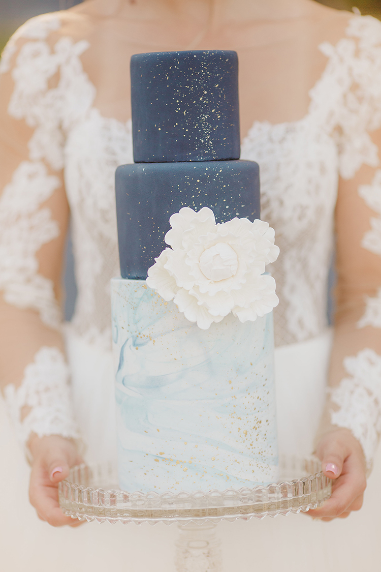 blue wedding cakes - photo by Kristen Booth Photographer http://ruffledblog.com/majestic-castle-wedding-inspiration-with-celestial-accents