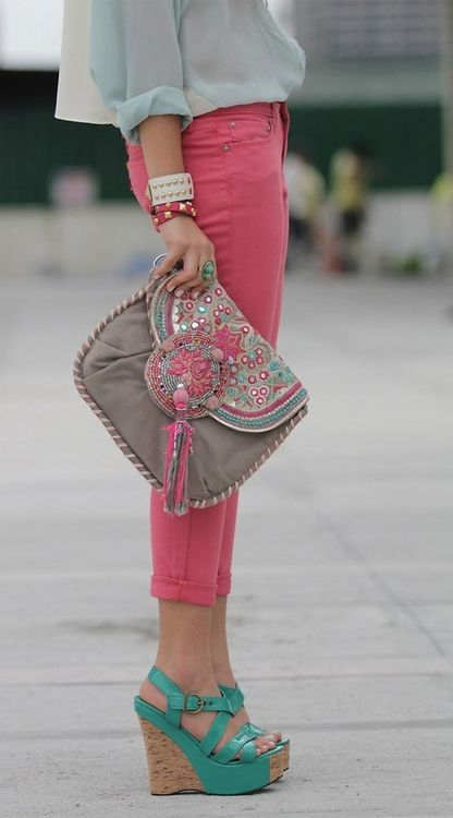 a grey clutch with pink and turquoise beads and sequins and a large tassel for a glam look
