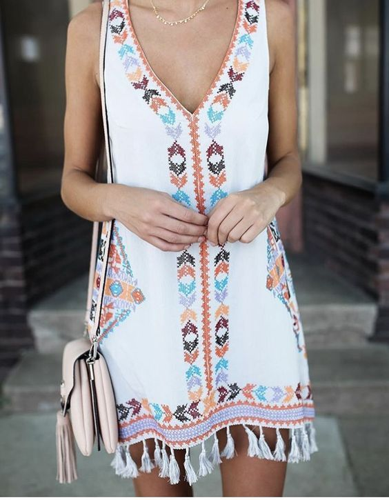 wide strap white mini dress with colorful embroidery and tassels