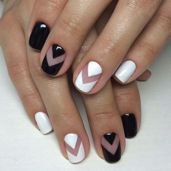 short square nails with black and white chevron accents