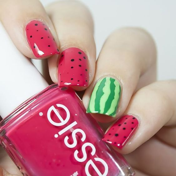 watermelon inspired nails - pink dotted ones and a striped green accent one