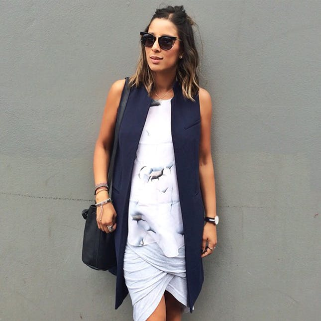 a printed top, a wrap skirt and a long navy vest can even hide your bump if you need