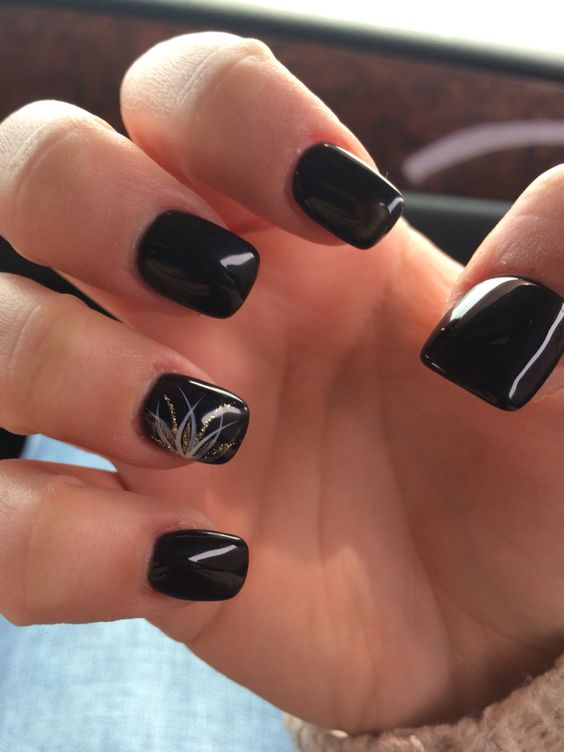 black manicure with a gold and silver glitter accent nail
