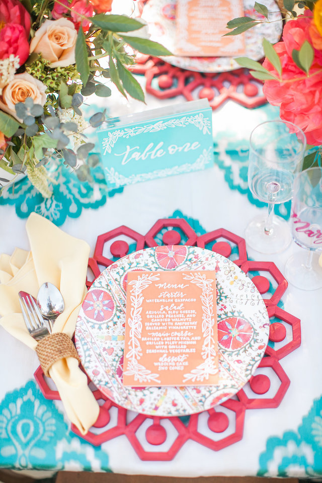 Colorful and bright summer wedding place setting | Nicole Chatham Photography