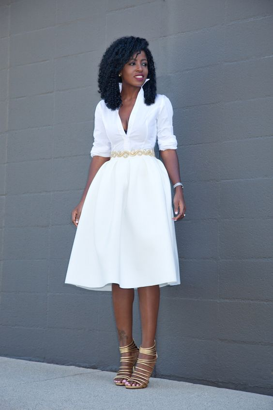 a white half sleeve dress with a deep V neckline, metallic shoes and accessories