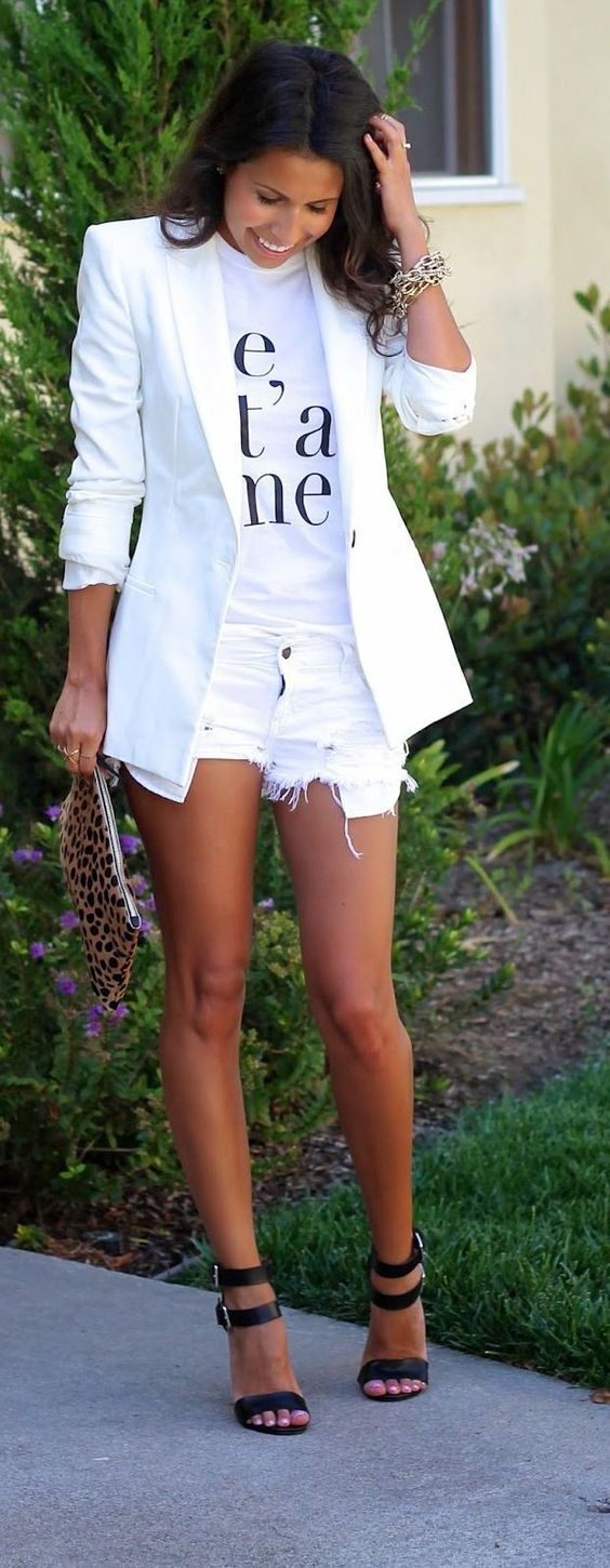 white denim shorts, a white printed tee, a white blazer and black strappy heels