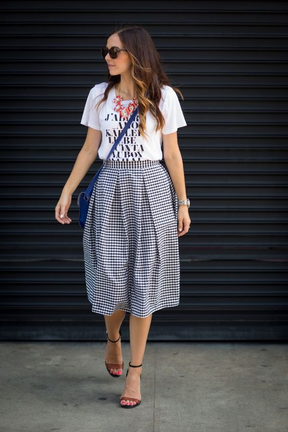 a printed tee, a statement necklace, a gingham midi skirt and ankle strap sandals
