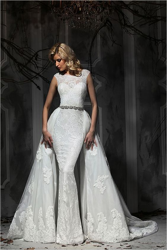 a sheath lace wedding dress with cap sleeves and a lace overskirt, an embellished belt