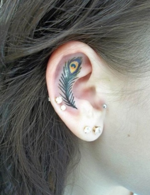 Feather tattoo on the ear