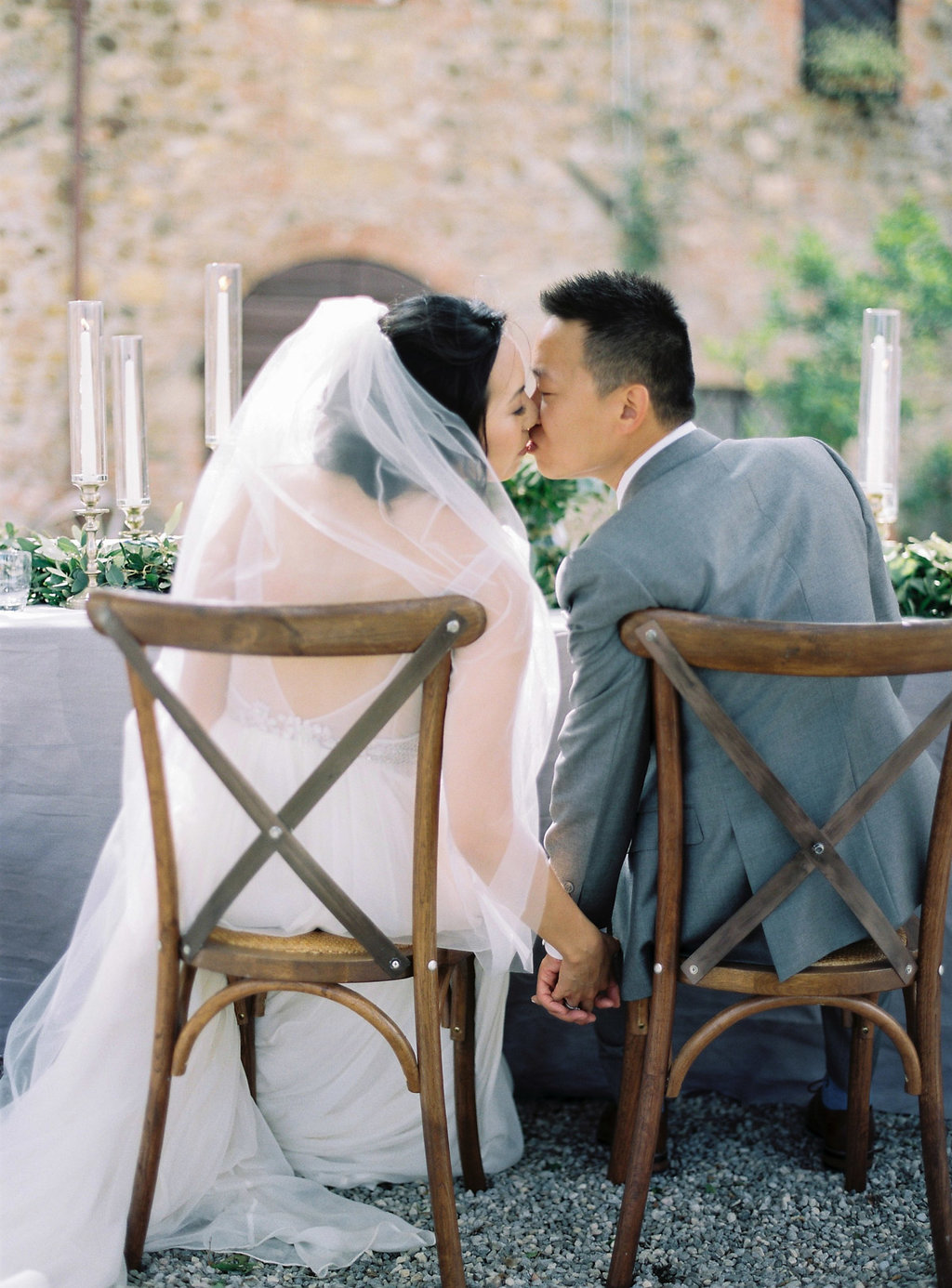 sweetheart table kisses - photo by Katie Grant Photography http://ruffledblog.com/classically-beautiful-intimate-wedding-in-tuscany