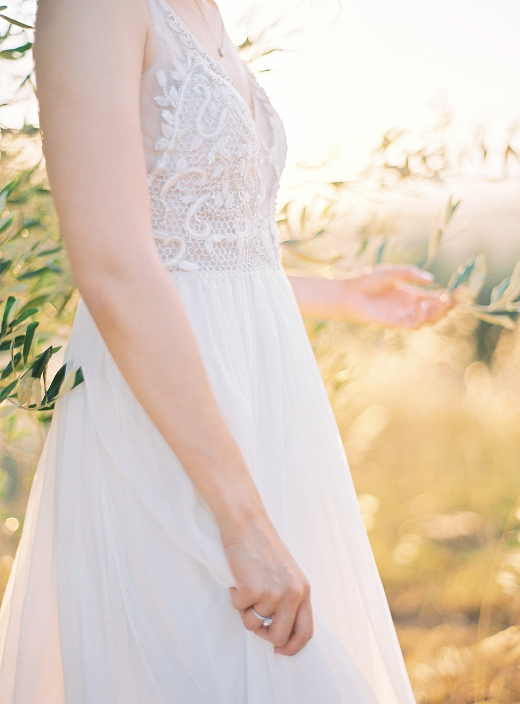 lace wedding dress details - photo by Katie Grant Photography http://ruffledblog.com/classically-beautiful-intimate-wedding-in-tuscany