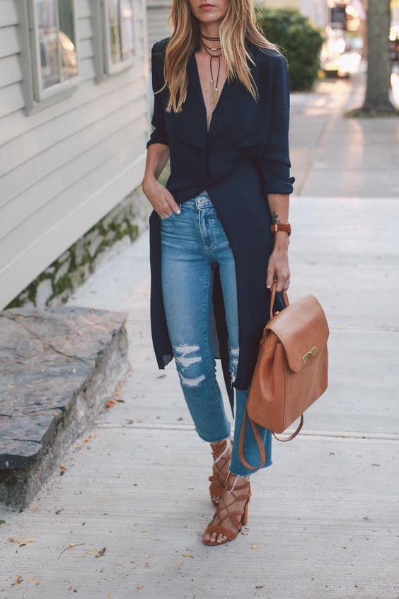 ripped cropper blue jeans, a black long shirt, brown lace up heels and a matching backpack
