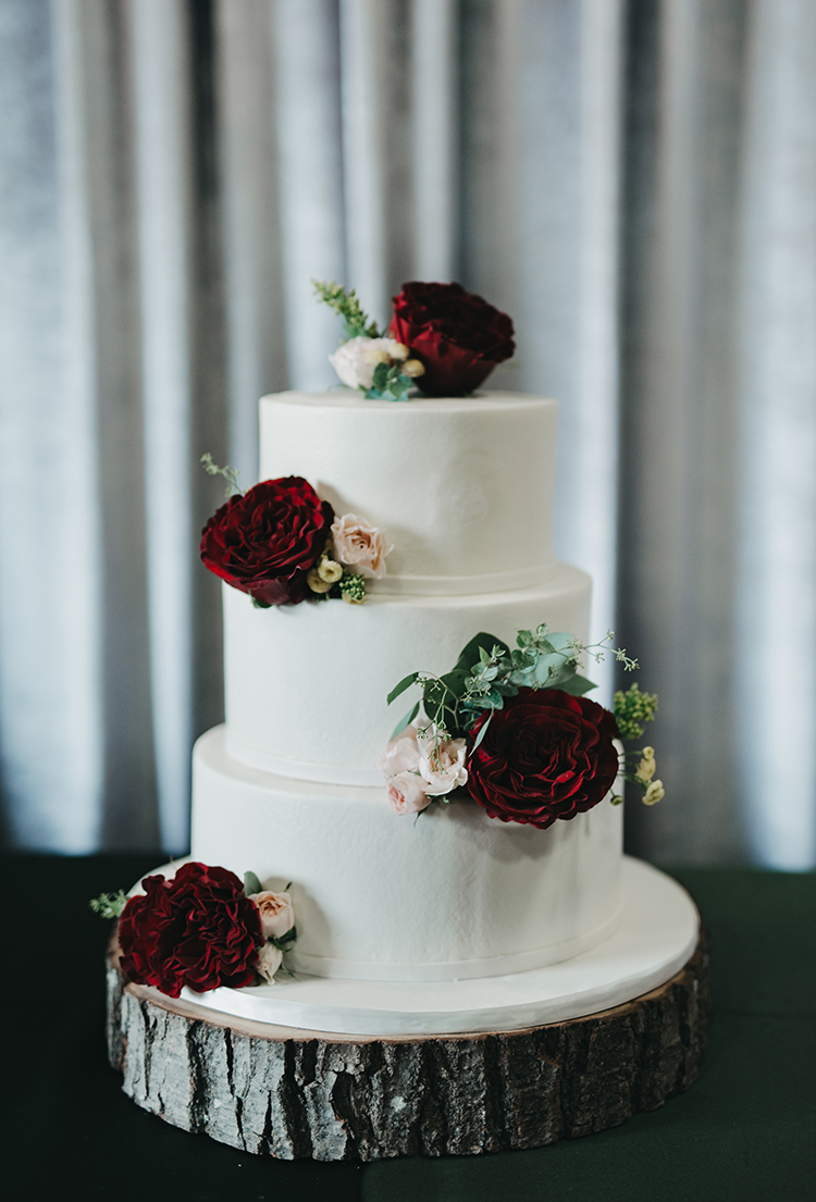 wedding cakes with red flowers - photo by Minerva House Photography http://ruffledblog.com/dreamy-waterfall-elopement-at-wahclella-falls