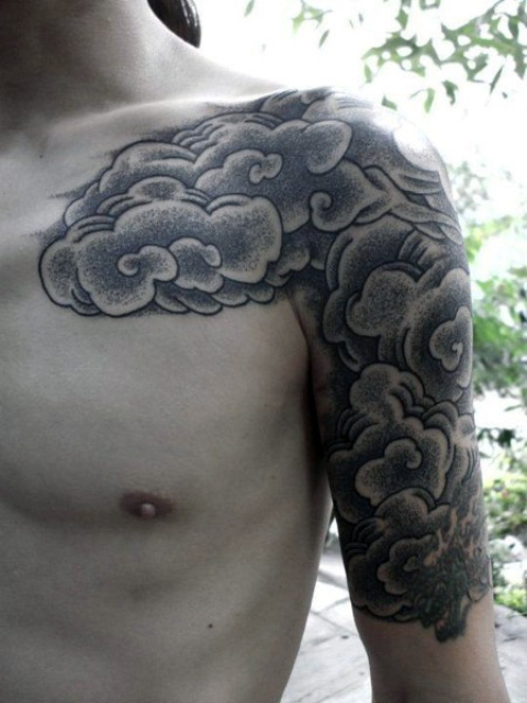 Black and white cloud tattoo on the shoulder and bicep