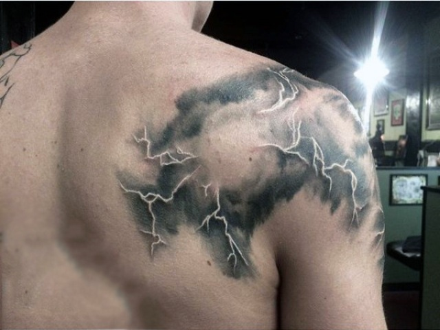 Cloud and lightning tattoo on the shoulder